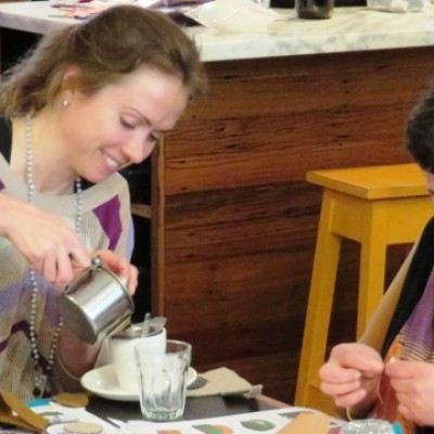 Laughing over tea and sewing