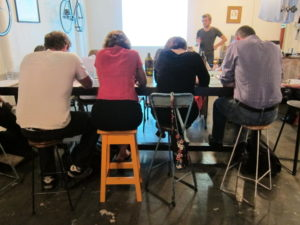 Students at a class learning to solve cryptic crosswords