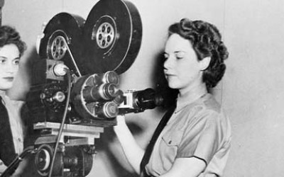 Two members of the Women's Australian Auxiliary Air Force (WAAAF) operate a film camera