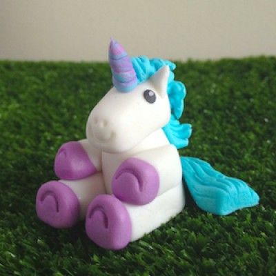 A cute, edible unicorn for the top of a cupcake
