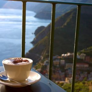 A cappuccino overlooking an Italian town.
