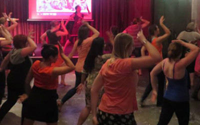 A class of people dancing a Bollywood routine