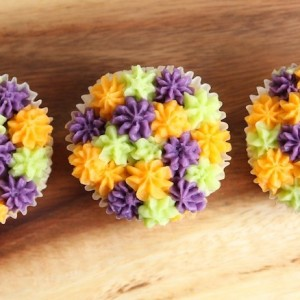 Cupcakes decorated with coloured buttercream piping
