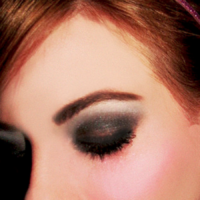 A woman wearing beautiful smoky eye make-up