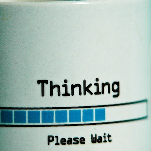 A mug with the words 'Thinking, please wait' and a progress bar