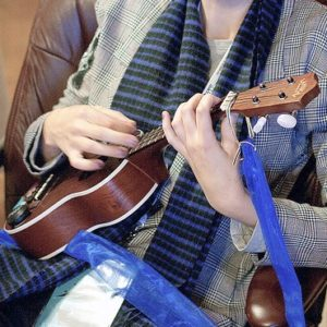 A person playing the ukulele.