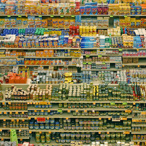 A supermarket shelf stacked high with food packets