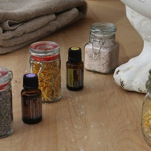 Small bottles of essential oils on a table.