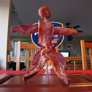 A stick figure made out of bacon