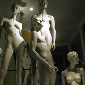 Nude mannequins in a shop window
