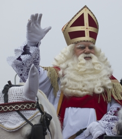 Sinterklaas, has a large white beard, long hair and wear red robes