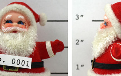 A Santa toy having a Police mug shot