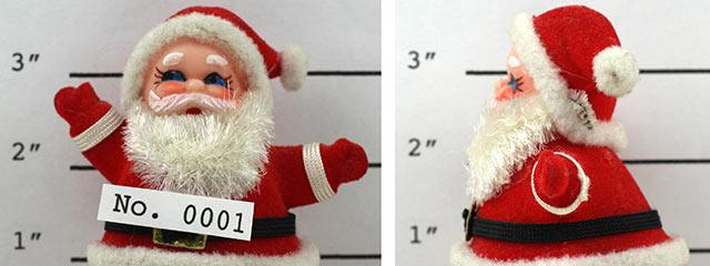 A Santa toy having a Police mug shot