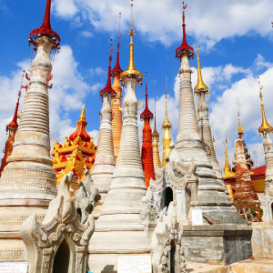Exotic white buildings with gold and red spires