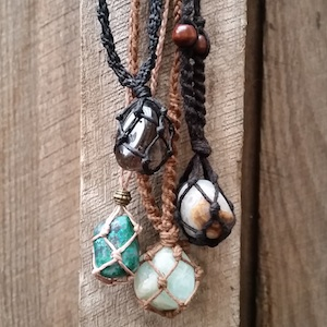 Crystal necklaces hanging on a wooden wall