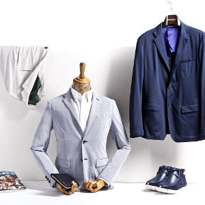 Stylish men's clothing and accessories on a mannequin and hanger