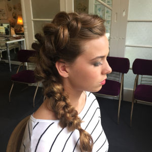A lady with a beautiful braid in her hair