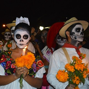 People dressed up and with skull face paint for Day of the Dead celebrations.