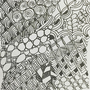 A black and white zentangle drawing of geometric shapes and patterns