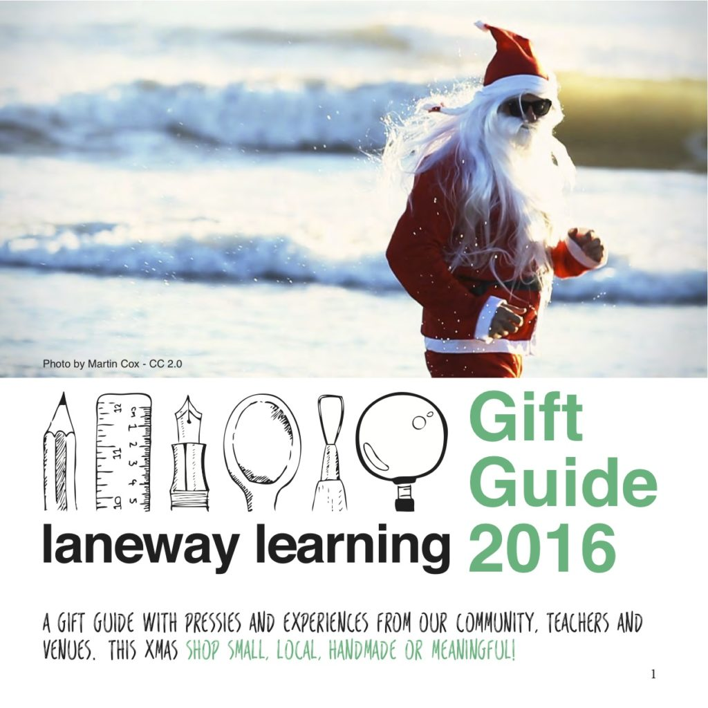 Guide guide front page with a person dressed as Santa running on a beach
