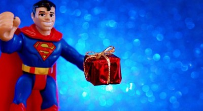 A toy Superman holding a present