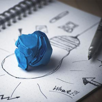 A ball of paper inside a drawing of a lightbulb