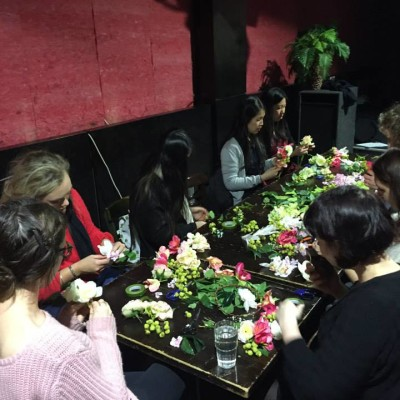 Students making flower crowns.