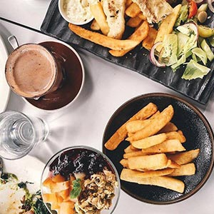 A bird's eye view of several food dishes and drinks on a table