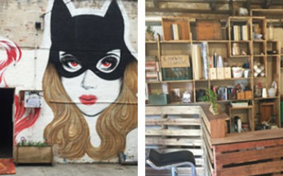A photo of the cat woman graffiti on the outside of Laneway Learning Central and some artistic shelves behind the wooden bar inside the workshop