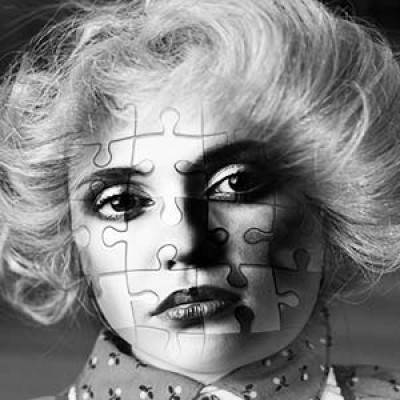 A woman's face with a jigsaw piece design over it