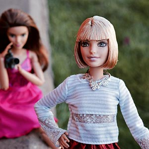 Two dolls as a model and photographer