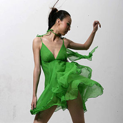 A woman in a green dress
