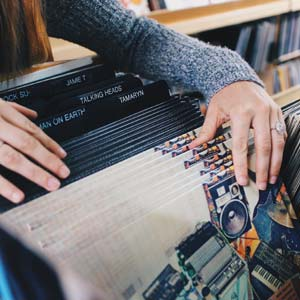A woman browsing through vinyl records