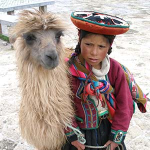 A Quechua girl and her llama in South America