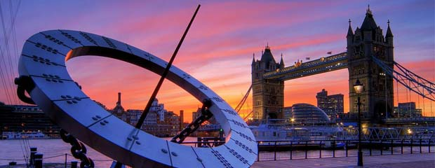 A modern sundial in front of Tower Bridge, London, at sunset