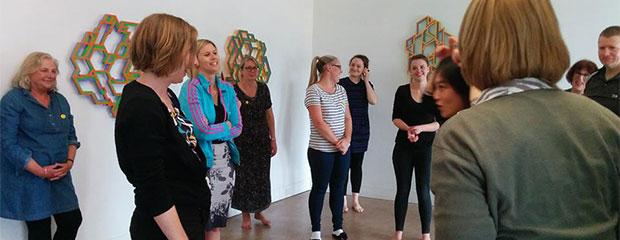 Students having fun at a laughter yoga class