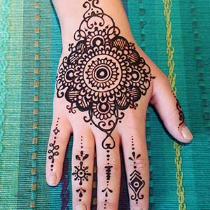 A hand decorated with henna designs
