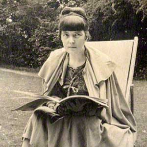 Katherine Mansfield sat with a book in a garden