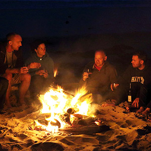 A group sat around a campfire telling stories
