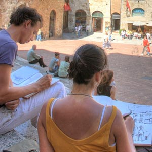 Two people sketching in an Italian square.