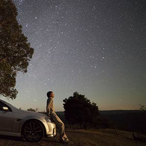 A person looking up at the stars.