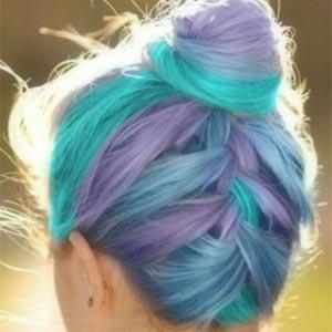 A beautiful upside-down braid in unicorn coloured hair.