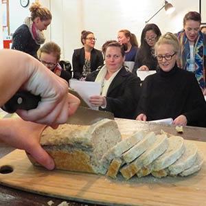 Slicing freshly baked bread.