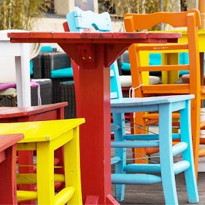 Brightly painted wooden chairs.