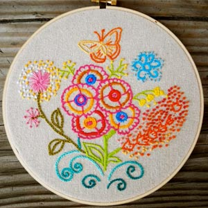 Brightly coloured embroidered flowers and butterflies.
