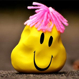 A yellow stress ball with a smiley face.