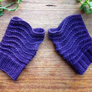 A pair of purple knitted fingerless gloves.