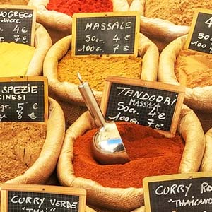 A brightly coloured spice market stall.