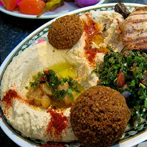 A Lebanese mixed plate, with hummus, falafel, tabboleh and breads.
