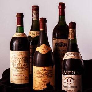 Bottles of vintage red wine.